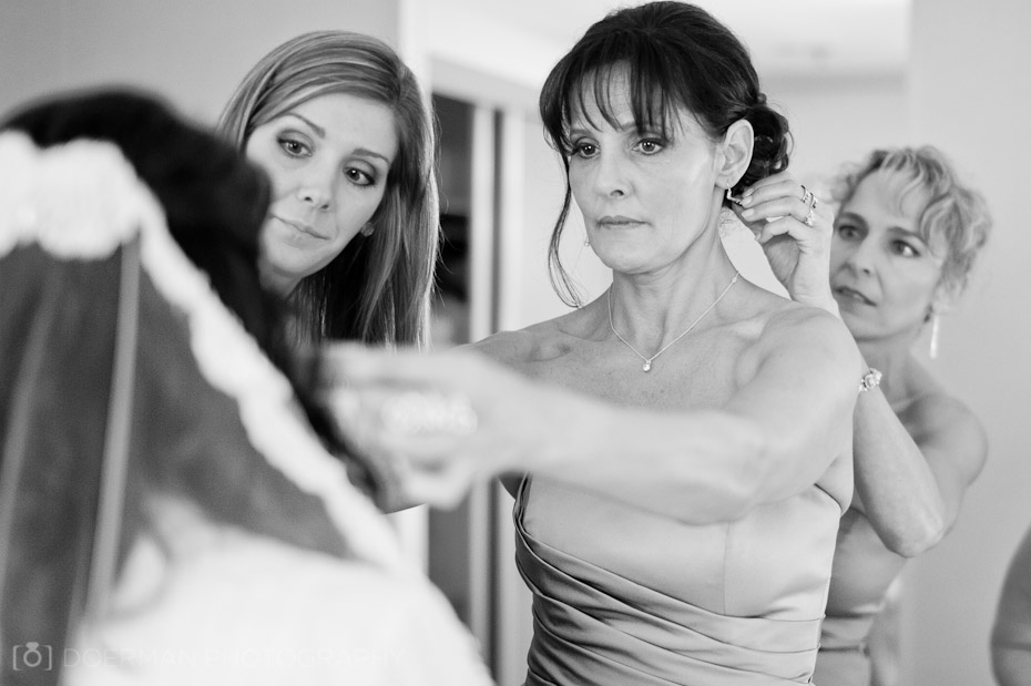 bridesmaids fixing veil