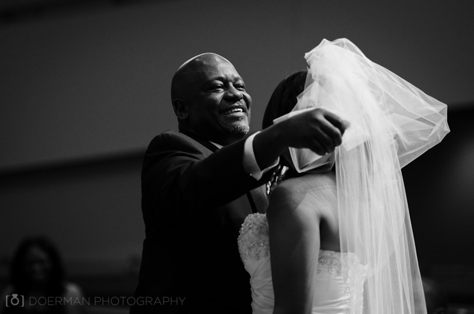 Father Lifting Wedding Veil