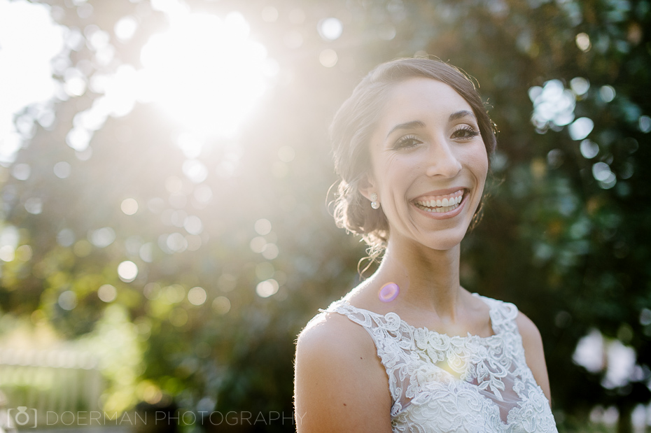 back-lit bride with lens flare