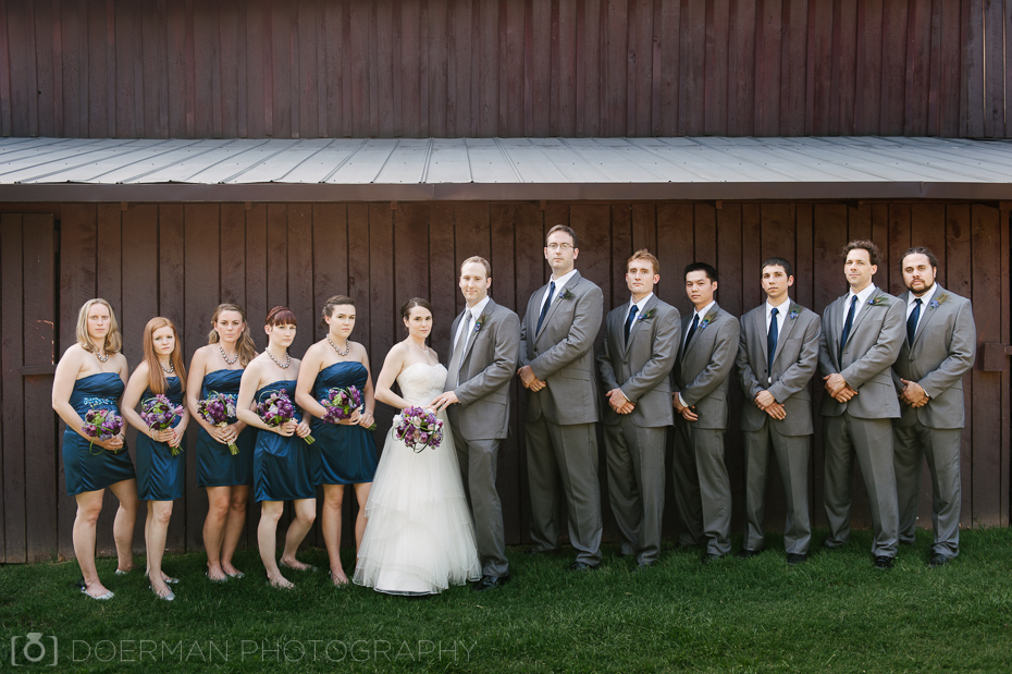 Cedarwood bridal party against barn