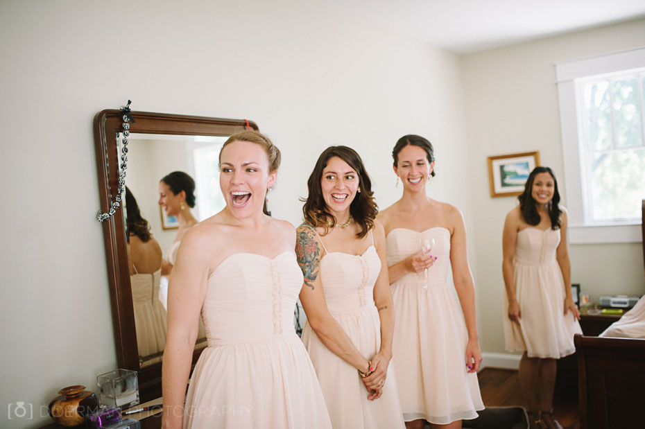 bridesmaids see bride before putting on dress