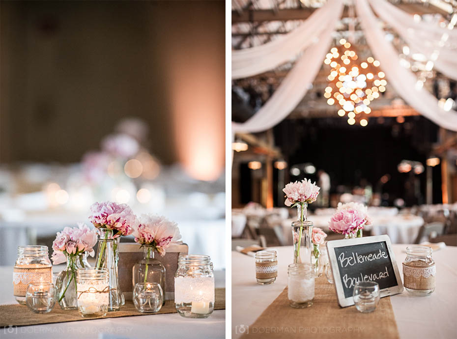 Pink and white burlap centerpiece with candles at the Loveless Barn