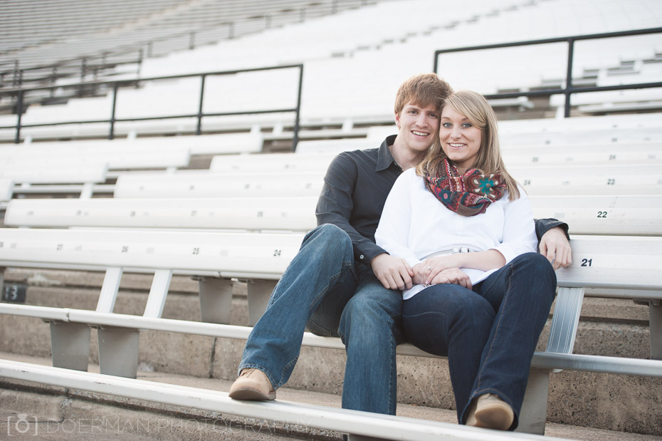 engagement photo on bleachers